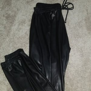 Black faux leather joggers
